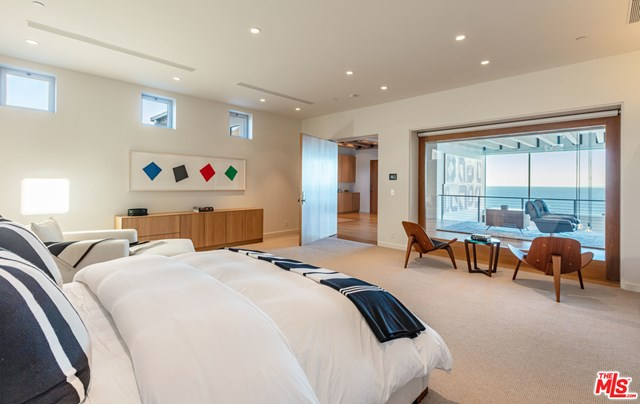 Bedroom in a $49,500,000 Malibu home for sale