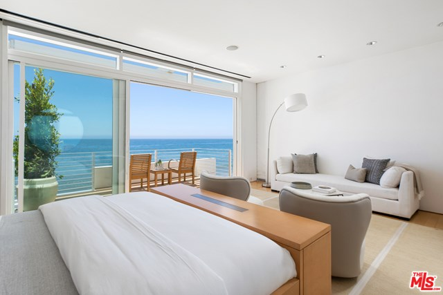 Bedroom in a $58,500,000 Malibu home for sale