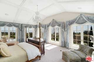 Bedroom in a $65,000,000 Summerland home for sale